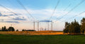 Electric pillars in a field Royalty Free Stock Photo