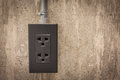 Electric plug on cement wall grunge background Royalty Free Stock Photography