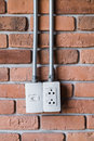 Electric plug outlet electic on beautiful brick wall Royalty Free Stock Photography