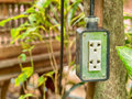 Electric plug socket in the garden. Royalty Free Stock Photo