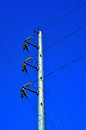 Electric pole against blue sky Stock Images