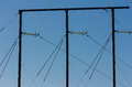 Electric pole against a blue sky Royalty Free Stock Photo