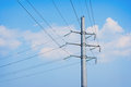 Electric pole on a background of blue sky wires Stock Photos