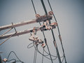 Electric pole with electric transformers and electrical cables Royalty Free Stock Photo