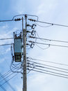 Electric pole and wire in blue sky Royalty Free Stock Photo