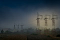 Electric poles in the countryside Stock Photography