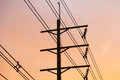 Electric poles and wires in the background is the sky in the evening sun Stock Image