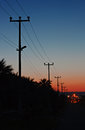 Electric power lines against a dawn sky new Stock Photos