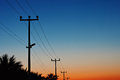Electric power lines against a dawn sky new Stock Image