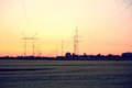 Electric power lines and pylon against blue sky Stock Images