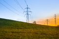 Electric power lines at sunset Royalty Free Stock Photo