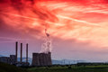 Electric power plant at dusk with orange sky in Kozani Greece Royalty Free Stock Photo