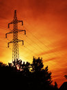 Electric power pylon at sunset Stock Image