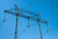 Electric power tower detail high energy isolated against blue sky Stock Image