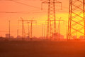 Electric power transmission lines at sunset Stock Photography
