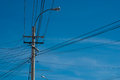 Electric pylon with cable silhouette of Stock Photography