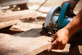 Electric saw cutting wood sheets Royalty Free Stock Image