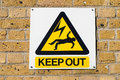 Electric shock death warning yellow sign on wall Royalty Free Stock Photo