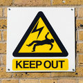 Electric shock death warning yellow sign on wall, squared Royalty Free Stock Photo