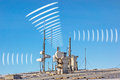 Electric smog antenna radiation antennas on roof symbolizing Stock Photography