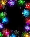 Electric star electrical christmas lanterns in the shape of stars and snowflakes on a black background Stock Photo