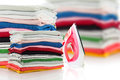 Electric steam iron and Pile of colorful clothes isolated on whi Royalty Free Stock Photo