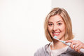 Electric toothbrush an attractive blonde lady uses an Royalty Free Stock Images