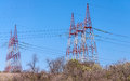 Electric towers row of high voltage on the field Royalty Free Stock Photography