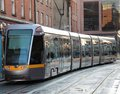 Electric tram a modern in a city setting Royalty Free Stock Photos