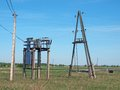 Electric transformer high to low voltage power line Royalty Free Stock Images