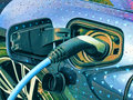 Electric vehicle being plugged in Royalty Free Stock Photo