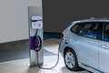 Electric vehicles and electric vehicle charging stations Royalty Free Stock Photo