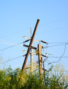 Electrical bamboo post with power line cables against bright blue sky Stock Images