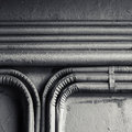 Electrical conduits mounted on old concrete wall abstract square industrial background group of bent vintage a Royalty Free Stock Images