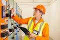 Electrical engineer successful writing down machine setting data Stock Image