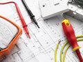 Electrical Equipment On House Plans Royalty Free Stock Photo