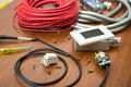 Electrical equipment on the wooden table Royalty Free Stock Image