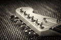 Electrical guitar headstock closeup with vignette and textured background Royalty Free Stock Image