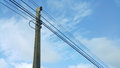 Electrical high tension lines against blue sky. Royalty Free Stock Photo