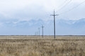 Electrical lines and pillars across the plain of upper Tibet Royalty Free Stock Photo