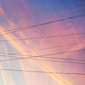 Electrical power cables and pink sunset clouds Royalty Free Stock Images
