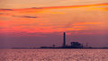 Electrical power plant against sunset silhouette of Stock Image