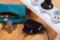 Electrical power strip with plug and polish currency money energy costs blue leather pocket purse concept of saving on electricity Stock Photography