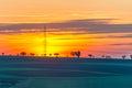 Electrical pylon at sunset Royalty Free Stock Photo