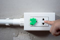 Electrical security for safety home of ac power outlet for babies, baby hands playing with electric plug. Royalty Free Stock Photo