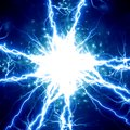 Electrical spark bright sparks on a dark blue background Royalty Free Stock Photography