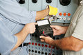 Electrical Team Testing Voltage Royalty Free Stock Photo