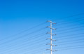 Electrical tower on blue sky with many power lines Royalty Free Stock Photo