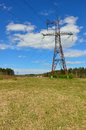Electrical transmission pylon in the field. Royalty Free Stock Photo