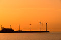 Electrical windmills silhouettes in the sunset Stock Photography